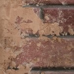 Faux painted bricks with broken stucco